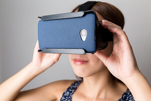Woman using the VR for watching film